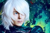 Close-up portrait of a handsome blond elf in the magic forest. Fantasy. Anime style. poster