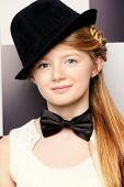 stock photo of bow tie hair  - Elegant teen girl wearing white dress - JPG