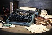 pic of typewriter  - Retro typewriter on wooden background - JPG
