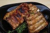 pic of roasted pork  - Roasted pork ribs with thyme and spices - JPG