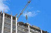 foto of formwork  - Crane hoisting formwork over construction site work - JPG