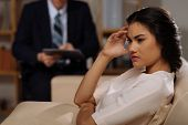 image of psychologist  - Young beautiful depressed woman on reception at psychologist - JPG