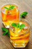 pic of iced-tea  - lemon iced tea on brown wooden table with mint around - JPG