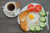 picture of scrambled eggs  - Breakfast with scrambled eggs vegetables toasts and a cup of coffee - JPG