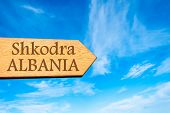image of albania  - Wooden arrow sign pointing destination Shkodra ALBANIA against clear blue sky with copy space available - JPG