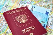 stock photo of passport cover  - Russian passport and Euro banknotes on the map background, the concept of tourism ** Note: Shallow depth of field - JPG