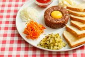 stock photo of yolk  - tartare meat with egg yolk - JPG