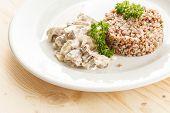 stock photo of porridge  - Buckwheat porridge with meat - JPG