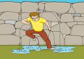 picture of dam  - Man covering trickling water coming out of rock dam - JPG