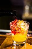 stock photo of sangria  - Bartender making Red Sangria in Italian restaurant - JPG