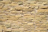picture of tile cladding  - Yellow cladding tiles imitating stones in sunny day - JPG