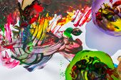 stock photo of finger-painting  - Overhead view of childs - JPG