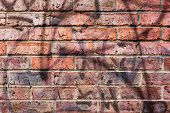 Vandalised Brickwork