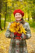 Woman With Maple Leaves
