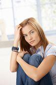 Attractive Woman Sitting On Floor Hugging Knees