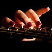 picture of transverse  - Fingers of a young woman playing transverse flute closeup - JPG