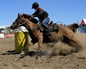 picture of barrel racing  - a cowgirl competing in the barrel race - JPG