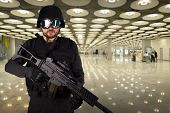 Defense Against Terrorism, A Soldier At An Airport