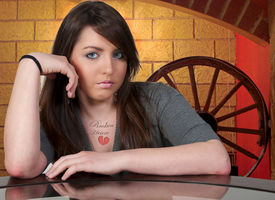 foto of broken heart  - A beautiful young woman with a tattoo that says Broken Heart - JPG