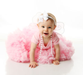 picture of newborn baby girl  - Portrait of a sweet infant wearing a pink tutu necklace and headband bow isolated on white in studio - JPG