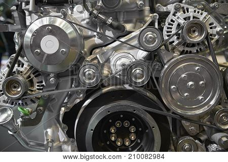 poster of Close up view on new truck diesel engine motor belt, pulleys, gears, alternator and other engine equipment. Assembled truck diesel engine. Abstract auto automotive industrial background pattern