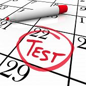 The 22nd day of the month is circled on a white calendar with a red marker with the word Test inside