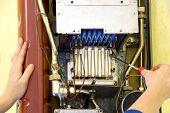 Hands Of A Plumber Repairing A Gas Heating