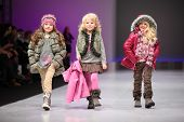 MOSCOW - FEBRUARY 22: Unidentified child models wear fashions by Snowimage and walk the catwalk in C