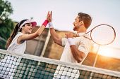 Couple On Tennis Court poster