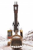Retro excavator in open pit