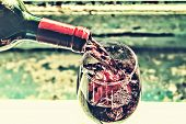 Pouring Wine. Red Wine In A Glass. Sommelier Wine Into The Glass On A Blue Background Old. poster