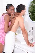 picture of mixing faucet  - Woman giving a man a massage - JPG