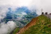 A wooden cross standing on top of Rigi mountain in Switzerland