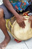 stock photo of congas  - Caribbean conga drummer performing in concert outdoors - JPG
