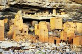 stock photo of dogon  - Close up of Dogon and Tellem houses at the base of the Bandiagara escarpment in Mali