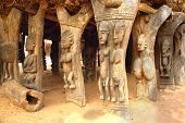 stock photo of dogon  - Wood carved human figures supporting a Dogon building in Mali - JPG