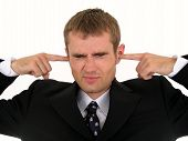 Businessman Putting Fingers In Ears