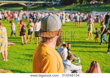 poster of Hipster In Cap Happy Celebrate Event Fest Or Festival. Summer Fest. Man Bearded Hipster In Front Of