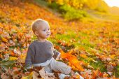Kids Fashion. Childhood Memories. Child Autumn Leaves Background. Warm Moments Of Autumn. Toddler Bo poster