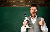 Surprised Student At Biology Lesson. Bearded Teacher In Classroom. Student Studying Into Classroom.  poster