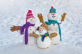 Funny Snowman Family In Stylish Hat And Scarf On Snowy Field. Happy Winter Time. Happy Funny Snowman poster