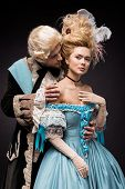 Handsome Victorian Man Looking At Young Beautiful Woman In Wig On Black poster