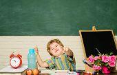 Little Schoolboy In Classroom. Schoolboy Doing Homework In Classroom At School. Elementary School Ki poster