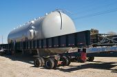 foto of oversize load  - Large storage tank loaded on oversized trailer - JPG