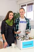young volunteer couple  doing community service with donation box