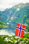Norwegian Flag And View Over Geirangerfjord From Flydalsjuvet Viewing Point. Tourist Attraction. Tou poster
