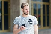 Modern Life Is Impossible Without Cellular Communication. Modern Guy With Smartphone On Urban Outdoo poster