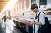 Asian Man Is Traveler, He Is Waiting For Their Train. Outdoor Adventure Travel By Train Concept. Ban poster