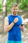 Set Up Application. Sportsman With Smartphone And Smart Watch Prepare For Jog. Training With Sport A poster
