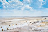 Sandy Coastline Of The Salty Lake Baskunchak. Lifeless Hot Terrain Without Vegetation And Animals. poster
